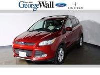This 2014 Ford Escape SE is proudly offered by George