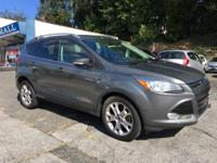 Look at this 2014 Ford Escape Titanium. Its Automatic