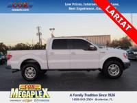 This 2014 Ford F-150 Lariat in Oxford White is well