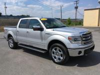 This 2014 Ford F-150 Lariat comes equipped with black