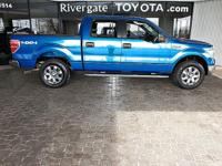This 2014 Ford F-150 XLT, has a great Blue Flame