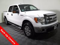 2014 Ford F-150 Super Crew 4X4 with a 5.0 V8 Engine.