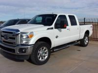 This 2014 Ford Super Duty F-250 SRW Lariat is proudly