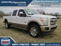 From mountains to mud, this White 2014 Ford Super Duty