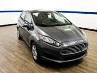 This outstanding example of a 2014 Ford Fiesta SE is