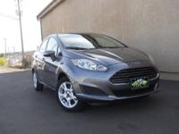 This stunning used 2014 Ford Fiesta SE runs like new