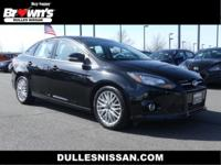 This 2014 Ford Focus Titanium is proudly offered by
