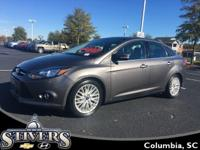 This 2014 Ford Focus Titanium offers    *Automatic