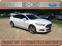 Energy-efficient and gas-saving, this 2014 Ford Fusion