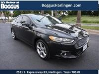 Get away in this 2014 Ford Fusion SE and experience a