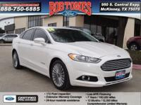 In this 2014 Ford Fusion Hybrid Titanium, enjoy every