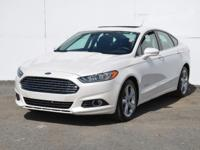 This 2014 Ford Fusion SE Hybrid is proudly offered by