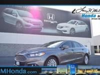 Snatch a deal on this 2014 Ford Fusion SE Hybrid before