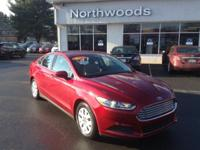 This outstanding example of a 2014 Ford Fusion S is