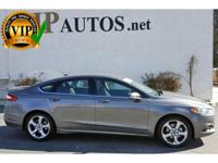 Simply stunning in Ingot Silver our 2014 Ford Fusion SE