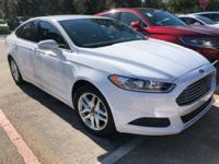 This outstanding example of a 2014 Ford Fusion 4dr Sdn
