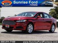 Prepare to turn heads in our 2014 Ford Fusion SE in