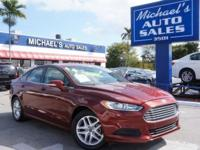 Options:  2014 Ford Fusion Se|Red|6-Speed Automatic.