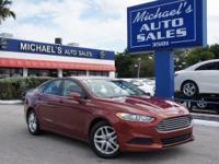 Options:  2014 Ford Fusion Se|Orange|6-Speed Automatic.
