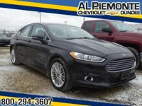 This 2014 ALMOST NEW Ford Fusion SE has a great looking