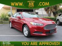 Options:  2014 Ford Fusion Se Has A Sharp Ruby Red