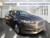 Racy yet refined, this 2014 Ford Fusion will envelope