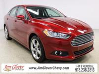 Drive home this 2014 Ford Fusion SE in Ruby Red