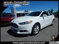 Boasts 37 Highway MPG and 25 City MPG! This Ford Fusion