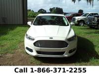 2014 Ford Fusion Titanium Hybrid Features: Leather
