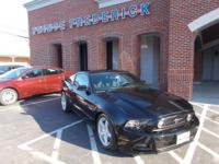 This 2014 Ford Mustang GT is equipped with luxury