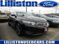 This 2014 Ford Taurus SEL has less than 35k miles.