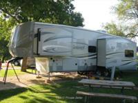 This 2014 Forest River Silverback 29RE is ready to make