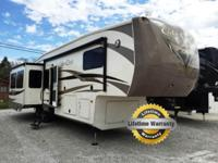 This triple slide Cedar Creek 36RKTS Fifth Wheel by