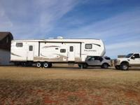 This is a 2014 Forest River Wildwood 33BHOK Fifth