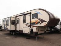 This 2014 Fox Mountain 325RKS 5th Wheel boasts all