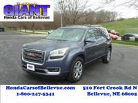 This outstanding example of a 2014 GMC Acadia SLT AWD