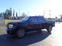 This 2014 GMC Sierra 1500 is complete with top-features