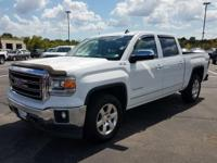Check out this Summit White 2014 GMC Sierra 1500 SLT
