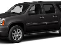 For a smoother ride, opt for this 2014 GMC Yukon XL