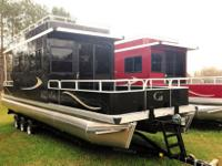 This is a new beautiful Grand Island 32 ft house boat
