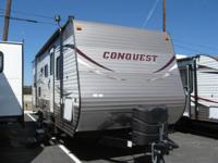 This Gulf Stream Conquest travel trailer is a splendid
