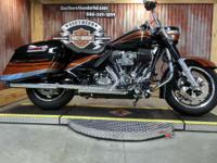 The Harley Road King showcases a powerful brand-new