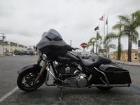 The 2014 Street Glide FLHXS motorcycle features the new
