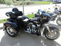 This beautiful 2014 Tri-Glide is as close to NEW as you