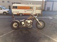 Well customized Harley twin cam powered chop. Bobber