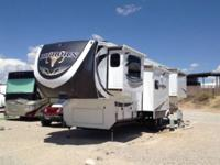 This 2014 Heartland is a 40 foot 5TH Wheel with 5