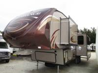A 32' Platinum edition Fifth Wheel with 3 slide-outs,