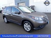 This 2014 CR-V has a clean CARFAX and has low miles