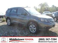 This outstanding example of a 2014 Honda CR-V EX-L is