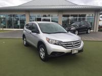 This 2014 Honda CR-V LX is proudly offered by